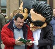 """26 April 2005; """"Bono"""" and Michael Drohan, from Waterford, study the race card before the Kildare Hunt Club Steeplechase. Punchestown Racecourse, Co. Kildare. Picture credit; Damien Eagers / SPORTSFILE"""