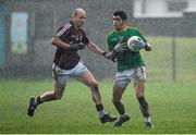 12 January 2014; Emlyn Mulligan, Leitrim, in action against James Kavanagh, Galway. FBD League, Section B, Round 2, Galway v Leitrim, Duggan Park, Ballinasloe, Co. Galway. Picture credit: Diarmuid Greene / SPORTSFILE