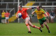12 January 2014; James Lavery, Armagh, in action against Neil Gallagher, Donegal. Power NI Dr. McKenna Cup, Section A, Round 2, Armagh v Donegal, Athletic Grounds, Armagh. Picture credit: Oliver McVeigh / SPORTSFILE