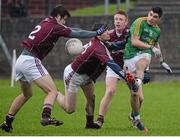 12 January 2014; Emlyn Mulligan, Leitrim, has his shot blocked down by James Shaughnessy, Joss Moore and Tom Fahy, Galway. FBD League, Section B, Round 2, Galway v Leitrim, Duggan Park, Ballinasloe, Co. Galway. Picture credit: Diarmuid Greene / SPORTSFILE