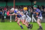 15 January 2014; Enda Heffernan, Thurles CBS, in action against Cathal Sheehan, left, Mark Dolan, St Francis College Rochestown, supported by Chris McCullagh, Thurles CBS. Dr. Harty Cup Quarter-Final, Thurles CBS v St Francis College Rochestown, Cahir, Co. Tipperary. Picture credit: Ramsey Cardy / SPORTSFILE