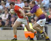1 May 2005; Ronan Clarke, Armagh, in action against Philip Wallace, Wexford. Allianz National Football League, Division 1 Final, Armagh v Wexford, Croke Park, Dublin. Picture credit; Brendan Moran / SPORTSFILE