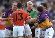 1 May 2005; Referee Gerry Kinneavy separates players from Armagh and Wexford. Allianz National Football League, Division 1 Final, Armagh v Wexford, Croke Park, Dublin. Picture credit; Brendan Moran / SPORTSFILE