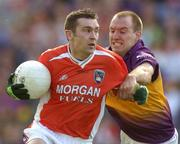 1 May 2005; Oisin McConville, Armagh, in action against Philip Wallace, Wexford. Allianz National Football League, Division 1 Final, Armagh v Wexford, Croke Park, Dublin. Picture credit; Brendan Moran / SPORTSFILE