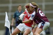 30 April 2005; Deirdre O'Reilly, Cork, is tackled by Maire O'Connell, Galway. Suzuki Ladies National Football League, Division 1 Final, Cork v Galway, Gaelic Grounds, Limerick. Picture credit; Ray McManus / SPORTSFILE