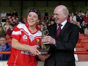 30 April 2005; Niall O'Gorman, General Manager, Suzuki Ireland. presents the ' Player of the Match' award to Cork's Valerie Mulcahy. Suzuki Ladies National Football League, Division 1 Final, Cork v Galway, Gaelic Grounds, Limerick. Picture credit; Ray McManus / SPORTSFILE