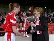 30 April 2005; Cork captain Juliette Murphy is presented with the trophy by Geraldine Giles, President, Cumann Peil Gael na mBan. Suzuki Ladies National Football League, Division 1 Final, Cork v Galway, Gaelic Grounds, Limerick. Picture credit; Ray McManus / SPORTSFILE