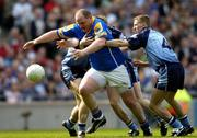 15 May 2005; Niall Sheridan, Longford, in action against Dublin players left to right, Paddy Christie, Paul Griffin and Stephen Shaughnessy. Bank Of Ireland Leinster Senior Football Championship, Dublin v Longford, Croke Park, Dublin. Picture credit; David Maher / SPORTSFILE