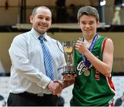22 January 2014; Eoin Rochall, Calasanctius College, is presented with the cup by Conor Lilly, Basketball Ireland. All-Ireland Schools Cup U16A Boys Final, Calasanctius College, Oranmore, Co. Galway v St Joseph's Patrician College, Nun's Island, Co. Galway. National Basketball Arena, Tallaght, Co. Dublin. Picture credit: David Maher / SPORTSFILE