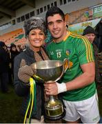 26 January 2014; Leitrim captain Emlyn Mulligan celebrates with his girlfriend Elaine Kearns at the end of the game. FBD League, Final, Leitrim v Roscommon. Páirc Sean Mac Diarmada, Carrick on Shannon, Co. Leitrim. Picture credit: David Maher / SPORTSFILE