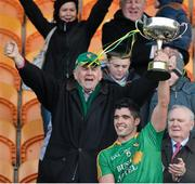 26 January 2014; Leitrim captain Emlyn Mulligan lifts the FBD Cup. FBD League, Final, Leitrim v Roscommon. Páirc Sean Mac Diarmada, Carrick on Shannon, Co. Leitrim. Picture credit: David Maher / SPORTSFILE