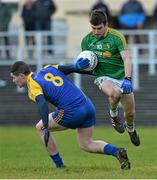 26 January 2014; Robert Lowe, Leitrim, in action against Cathal Shine, Roscommon. FBD League, Final, Leitrim v Roscommon. Páirc Sean Mac Diarmada, Carrick on Shannon, Co. Leitrim. Picture credit: David Maher / SPORTSFILE