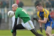 26 January 2014; Robert Lowe, Leitrim, in action against Craig Burns, Roscommon. FBD League, Final, Leitrim v Roscommon. Páirc Sean Mac Diarmada, Carrick on Shannon, Co. Leitrim. Picture credit: David Maher / SPORTSFILE