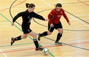 31 January 2014; Patrice Kearney, UCC, in action against Jenny Ferrari, Carlow IT. WSCAI National Futsal Finals, Plate Final, UCC v Carlow IT, The Mardyke, UCC, Cork. Picture credit: Diarmuid Greene / SPORTSFILE