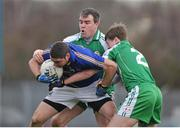 2 February 2014; Seanie Furlong, Wicklow, in action against Shane Mulligan, left, and Philip Butler, London. Allianz Football League, Division 4, Round 1, Wicklow v London, County Grounds, Aughrim, Co. Wicklow. Picture credit: Dáire Brennan / SPORTSFILE