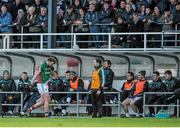 2 February 2014; Aidan O'Shea, Mayo, walks past the Kildare dugout after being shown the black card by referee Rory Hickey early in the game. Allianz Football League, Division 1, Round 1, Kildare v Mayo, St Conleth's Park, Newbridge, Co. Kildare. Picture credit: Piaras Ó Mídheach / SPORTSFILE