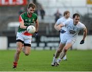 2 February 2014; Jason Gibbons, Mayo, in action against Michael Foley, Kildare. Allianz Football League, Division 1, Round 1, Kildare v Mayo, St Conleth's Park, Newbridge, Co. Kildare. Picture credit: Piaras Ó Mídheach / SPORTSFILE