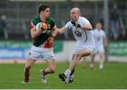 2 February 2014; Lee Keegan, Mayo, in action against Hugh McGrillen, Kildare. Allianz Football League, Division 1, Round 1, Kildare v Mayo, St Conleth's Park, Newbridge, Co. Kildare. Picture credit: Piaras Ó Mídheach / SPORTSFILE