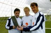 3 June 2005; Pictured are Irish soccer stars Andy Reid, Damien Duff, and Kenny Cunningham reading e wishes from the Irish fans using a wireless hotspot ahead of tomorrow's crunch world cup qualifier with Israel at Lansdowne Road. Tomorrow Lansdowne Road will become eircom's 300th wireless hotpspot. Malahide FC, Malahide, Dublin. Picture credit; Damien Eagers / SPORTSFILE