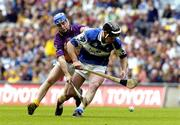 12 June 2005; Packie Cuddy, Laois, in action against Michael Jordan, Wexford. Guinness Leinster Senior Hurling Championship Semi-Final, Wexford v Laois, Croke Park, Dublin. Picture credit; Pat Murphy / SPORTSFILE