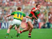 Mayo's Colm McManaman is tackled by Kerry's Liam Hassett at the,All Ireland Football Final 1997, Croke Park, 28/9/97.  Photograph Brendan Moran SPORTSFILE. 27/9/97