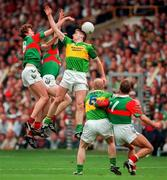Kerry's Dennis O'Dwyer goes up for the ball with Mayo's Pat Fallon and David Heaney All Ireland Football Final 1997, Croke Park, 28/9/97. Photograph Brendan Moran SPORTSFILE. 27/9/97