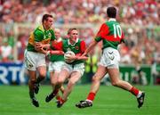 David Heaney Mayo in action against William Kirby Kerry, Maurice Sheridan ( 10 ), All Ireland Football Final 1997, Croke Park, 28/9/97. Photograph Brendan Moran SPORTSFILE.