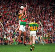 Kerry's William Kirby goes up for the ball with Mayo's Liam  McHale during the All Ireland Football Final 1997,  Croke Park, 28/9/97. Photograph Brendan Moran SPORTSFILE. 28/9/97