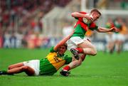 David Heaney Mayo in action against Maurice Fitzgerald Kerry, All Ireland Football Final 1997, Croke Park, 28/9/97. Photograph Ray McManus SPORTSFILE.