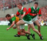 Kerry's Denis O'Dwyer is tackled by Mayo's David Heaney and Fergal Costello during the All Ireland Football Final 1997,  Croke Park, 28/9/97. Photograph Brendan Moran SPORTSFILE. 28/9/97