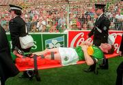 Kerry's Billy O'Shea is stretcherd of with a suspected broken leg during the all Irelad Football Final 1997,  Croke Park, 28/9/97. Photograph David Maher SPORTSFILE. 28/9/97