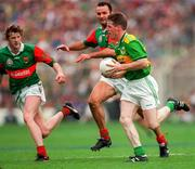 Eamonn Breen Kerry in action against Liam McHale and Pat Fallon Mayo ( Far Left ), All Ireland Football Final 1997, Croke Park, 28/9/97. Photograph Ray McManus SPORTSFILE.