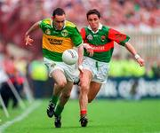 Kerry's Pa Laide  races away from Mayo's Noel Connelly. Kerry V Mayo, All Ireland Football Final 1997, Croke Park. 28/9/97. Photograph Ray McManus SPORTSFILE.