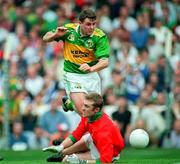 Kerry's Denis O'Dwyer has his shot saved by Mayo goalkeeper Peter Burke. Kerry V Mayo, All Ireland Football Final 1997, Croke Park. 28/9/97. Photograph Ray McManus SPORTSFILE.