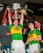 Kerry's Mike Hassett lifts the Sam Maguire trophy. Kerry V Mayo, All Ireland Football Final 1997, Croke Park. 28/9/97. Photograph Brendan Moran SPORTSFILE.