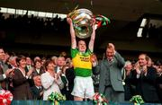 Liam Hassett Kerry Captain lifts the Sam Maguire Cup, All Ireland Football Final 1997, Croke Park, 28/9/97. Photograph Ray McManus SPORTSFILE.