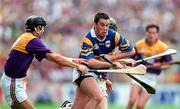 17 August 1997; Liam McGrath of Tipperary in action against John O'Connor, left, and Sean Flood of Wexford during the GAA All-Ireland Senior Hurling Championship Semi-Final match between Tipperary and Wexford at Croke Park in Dublin. Photo by David Maher/Sportsfile