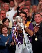 Wexford captain Martin Storey kisses the Liam MacCarthy cup after his side's victory against Limerick in the 1996 All Ireland Hurling Final. Picture credit: Brendan Moran / SPORTSFILE
