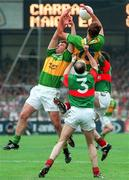 Kerry's Maurice Fitzgerald goes up for the ball with team mate Denis O'Dwyer and Mayo's Pat Homes  All Ireland Football Final 1997, Croke Park, 28/9/97. Photograph Dave Maher SPORTSFILE. 27/9/97