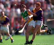 Michael Duignan Offaly in action against Rod Guiney Wexford, Leinster Final, 14/7/96.  Photograph Ray McManus SPORTSFILE.