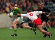 Kerry v Tyrone All Ireland Minor Football Semi Final 6/9/1997 Kerry's Noel Kennelly is tackled by Tyrone's Ciaran Gourley Photograph Matt Browne SPORTSFILE