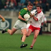 Kerry v Tyrone All Ireland Minor Football Semi Final 6/9/1997 Kerry's Noel Kennelly is tackled by Tyrone's Adrian Ball Photograph Matt Browne SPORTSFILE