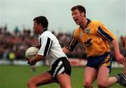 Sligo's Neil Carew gets away from Roscommon's Nigel Dineen during the   Connacht Football semi-final.  22/6/97. Photograph SPORTSFILE.