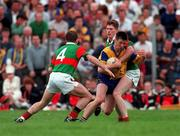 Nigel Dineen Roscommon football in action against Kevin Cahill and Kenneth Mortimer Mayo during the Connacht Championship, 23/6/96. Photograph Ray McManus SPORTSFILE