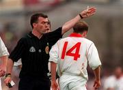 Referee Pat McEneaney sends off Tyrone's Peter Canavan during the Ulster C'ship game between Tyrone and Derry in Clones. 30/6/96. Photograph: David Maher SPORTSFILE.