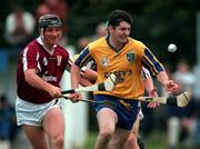 Galway's Tom Helebert tackles Roscommon's Pat Regan during the Connacht Hurling Final at Athleague. 12/7/97. Photograph Ray McManus SPORTSFILE
