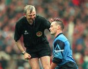 Referee Tommy Sugrue shares a joke with Dublin's Paul Curran during the 1994 All-Ireland Football Final between Duhlin and Down. 18/9/94. Photograph Ray McManus SPORTSFILE