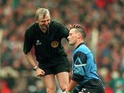 Paul Curran, Dublin gets a pat on the head from Referee Tommy Sugrue during the 1994 All-Ireland Football FInal. 18/9/94. Photograph Ray McManus SPORTSFILE