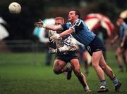 Tomo Lynch of Dublin in action against Robbie Lambe of Blue Stars at St. Vincent's GAA grounds. Photo by David Maher/Sportsfile