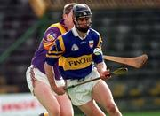z21 March 1999; Thomas Dunne Tipperary in action against Ger Cushe Wexford, Tipperary v Wexford, National Hurling League,Thurles. Picture credit; Damien Eagers/SPORTSFILE